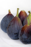 Whole, organic figs on a white plate Royalty Free Stock Image