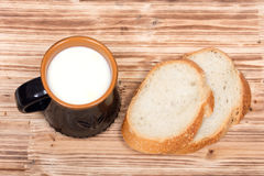 Whole organic milk and sliced french bread Stock Photos