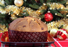 Whole Panettone in front of Christmas Tree Stock Photography