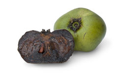Whole and partial black sapote fruit Stock Photography