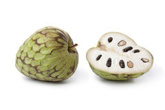 Whole and partial Cherimoya fruit Royalty Free Stock Photos
