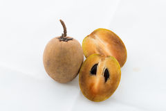 Whole and partial fresh sapodilla isolated Royalty Free Stock Images