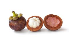 Whole and partial mangosteen Royalty Free Stock Photography