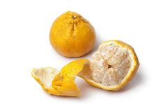 Whole and partial peeled ugli fruit Stock Images