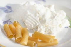 Whole pasta and ricotta Stock Photos