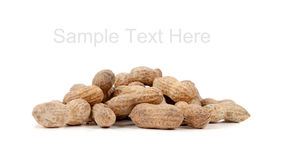 Whole peanuts on white with copy space Stock Photo