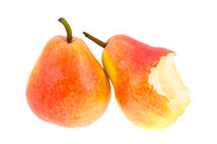 The whole pear and the bitten-off pear. Royalty Free Stock Photography