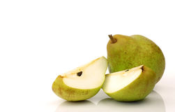 A whole pear and some pieces Stock Photo