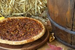 Whole Pecan Pie. On a wooden plate Stock Photography