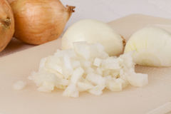 Whole, peeled and diced brown onion Stock Photo