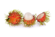 Whole and peeled fresh rambutan on white background. Whole and peeled fresh rambutan on a white background Royalty Free Stock Photography