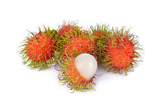 Whole and peeled fresh rambutan on white background. Whole and peeled fresh rambutan on a white background Stock Image