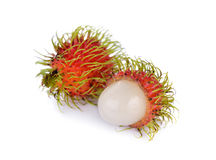 Whole and peeled fresh rambutan on white background. Whole and peeled fresh rambutan on a white background Stock Photo