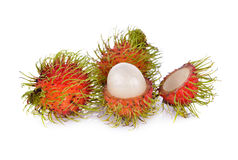Whole and peeled fresh rambutan on white background. Whole and peeled fresh rambutan on a white background Royalty Free Stock Photo