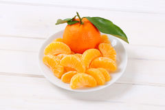 Whole and peeled oranges Stock Image