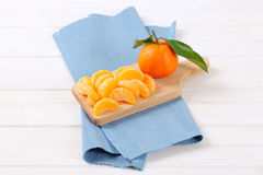Whole and peeled oranges Royalty Free Stock Photography