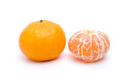 Whole and peeled tangerine Stock Photos