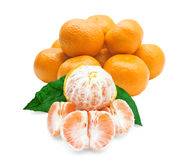 Whole and peeled tangerines Stock Images