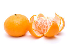 Whole and peeled tangerines Stock Image