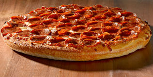 Whole pepperoni pizza Stock Image