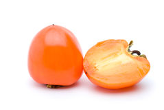 Whole persimmon and half Stock Image