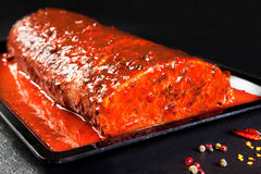 Whole piece of marinated pork ready to cook Stock Image