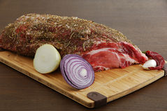 Whole piece of raw  meat with spices Stock Image