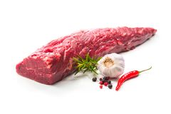Whole piece of tenderloin ready to cook  on white backgr. Fresh and raw beef meat. Whole piece of tenderloin ready to cook  on white background Royalty Free Stock Photos