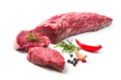 Whole piece of tenderloin with steaks and spices ready to cook i. Fresh and raw beef meat. Whole piece of tenderloin with steaks and spices ready to cook  on Stock Image