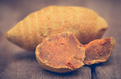 Whole with pieces of turmeric Royalty Free Stock Image