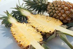 Pineapples. Whole pineapples heap on table, selective focus Stock Photo