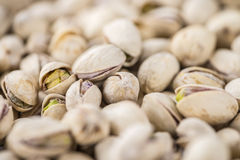Whole Pistachios on wood Royalty Free Stock Photos