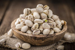 Whole Pistachios on wood. As detailed close-up shot (selective focus stock photos