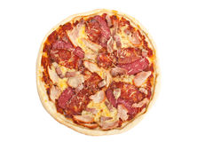 Whole pizza with different meat toppings Royalty Free Stock Photography