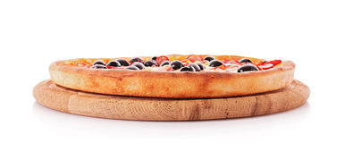 Whole pizza plate isolated. Sideview Stock Photos