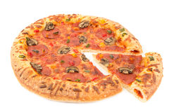 Whole pizza top view with a slice cut Royalty Free Stock Photography