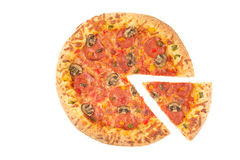 Whole pizza top view with a slice cut Stock Image
