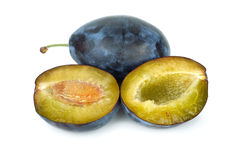 Whole plum and halves Royalty Free Stock Photo