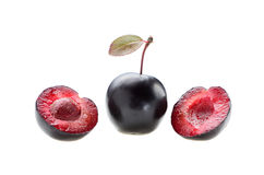 Whole plum with two halves and bone isolated on a white backgrou Stock Photos