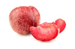Whole pluot fruit with delicious juicy slices on white Royalty Free Stock Images