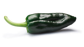 Whole Poblano Ancho pepper, paths. Immature whole Poblano pepper Capsicum annuum, also called Ancho when ripe. New Mexico Numex chile. Clipping paths, shadow stock photos