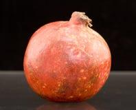 Whole Pomegranate Fruit. A pomegranate fruit on black Royalty Free Stock Photos