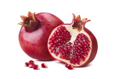 Whole pomegranate half seeds isolated on white Royalty Free Stock Image