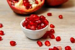 Whole pomegranate, part of pomegranate and pomegranate seeds stock photos