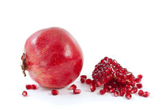 Whole pomegranate\ piece and some beries. Isolated on the white background Stock Image