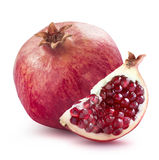 Whole pomegranate and quarter slice  on white background. Whole pomegranate and quarter piece  on white background as package design elements Stock Photos