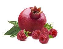 Whole pomegranate raspberry leaves isolated on white background royalty free stock images