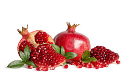 Whole Pomegranates and three part of Pomegranate with leaves Royalty Free Stock Images