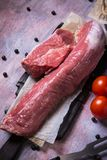 Whole pork tenderloin meat on vintage wooden board Royalty Free Stock Photo
