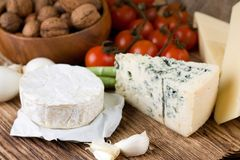 Whole portion of camembert with other kinds of cheese Royalty Free Stock Photos